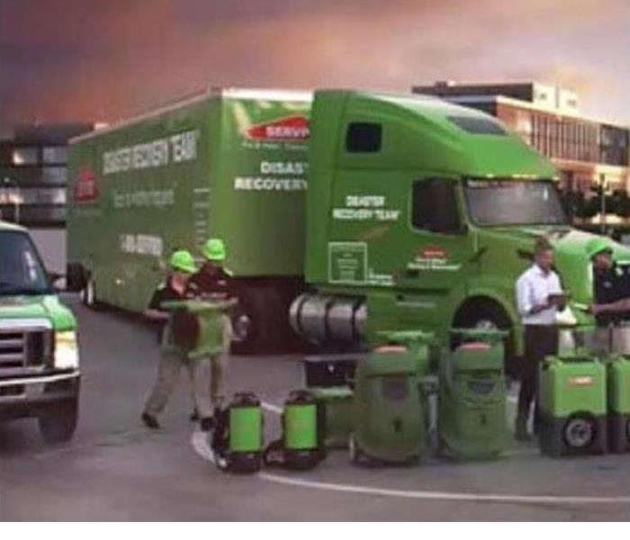 Image of SERVPRO semi with workers around it